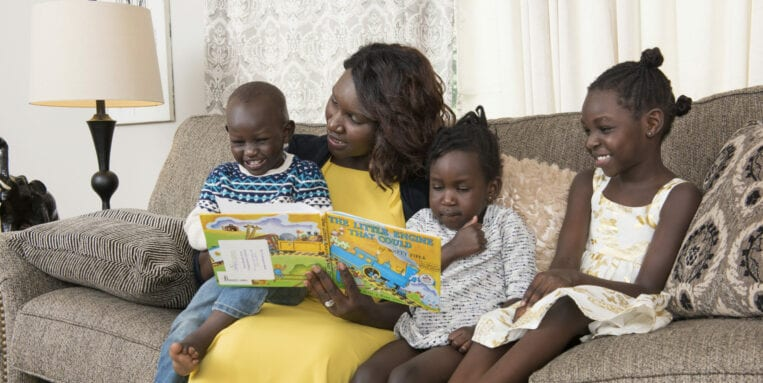 Chol Majok's family enjoys story time thanks to the Imagination Library.