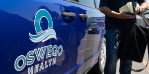 A mobile unit is prepping to respond to a crisis for Oswego Behavioral Health.