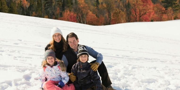 The Breuer family pose in the snow while sledding