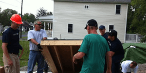 Volunteers help construct a Habitat for Humanity home.