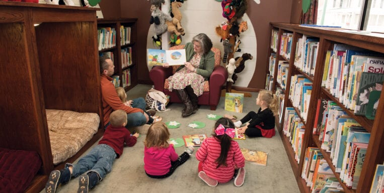 Children listen in a reading circle at Earlville Library