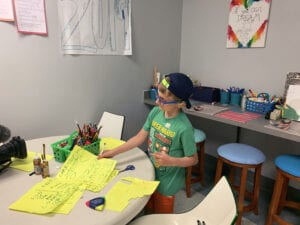 a child participates in activity in classroom setting.