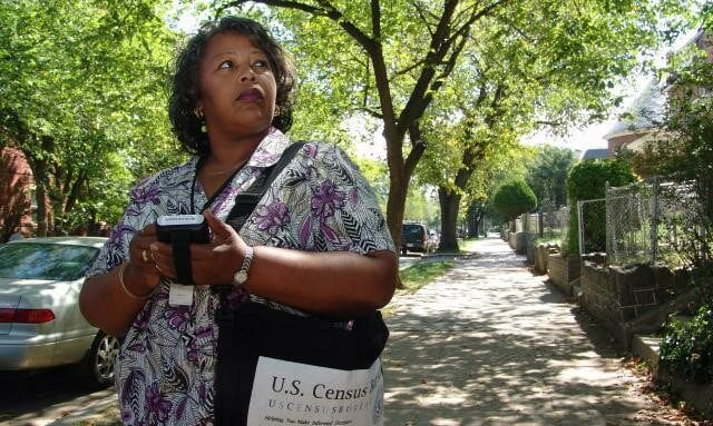 Woman going around the community for the U.S. Census.