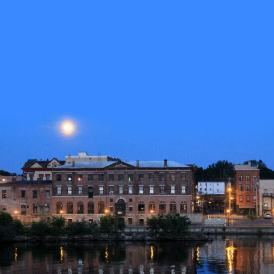 Beautiful moon-lit scene with several warehouses and other buildings on the shores of Lake Ontario, Oswego, New York.